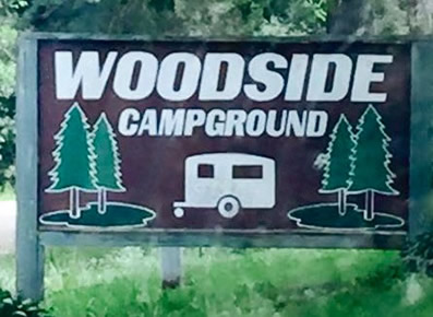Color photo of sign at entrance of Woodside Campground.